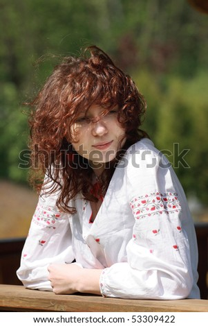 Red-haired girl with wavy hair - stock photo