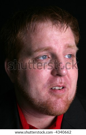 Red haired man with dynamic lighting from the side