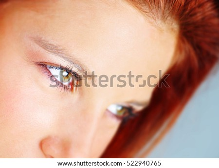 Red haired model looking. Focus on one eye.