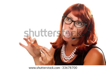 Red Haired Retro Receptionist Blowing a Bubble Isolated on a White Background. - stock photo