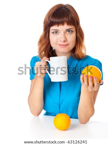 Red-haired teen-girl with cup of coffee and two oranges in hand. Isolated on white - stock photo