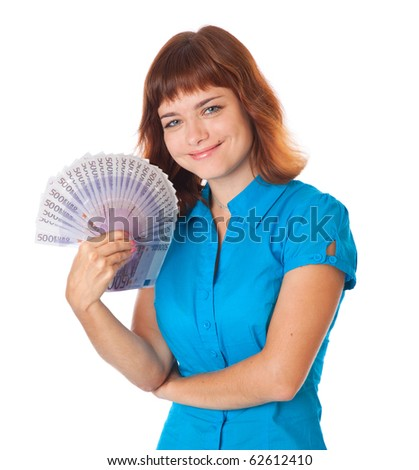 Red-haired teen-girl with money in hand. Isolated on white background