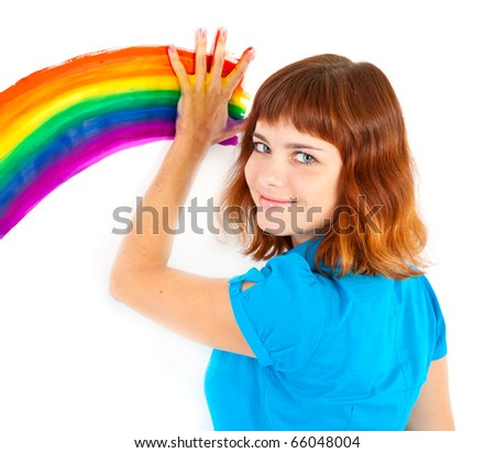 Red-haired teenager girl draw rainbow by palm. Isolated on white background