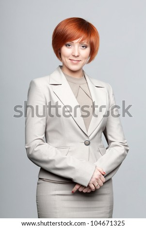 Red-haired woman in business clothing - stock photo
