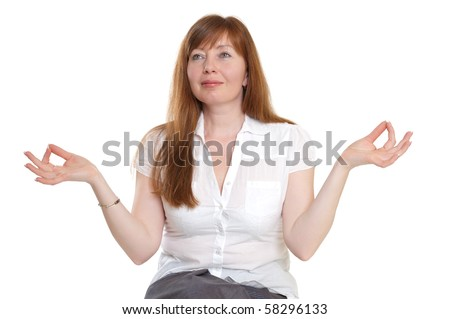 red-haired woman meditating on a white background - stock photo