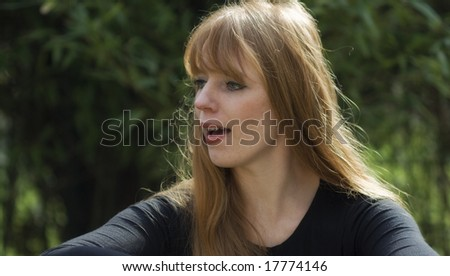 Red-haired woman - surprised