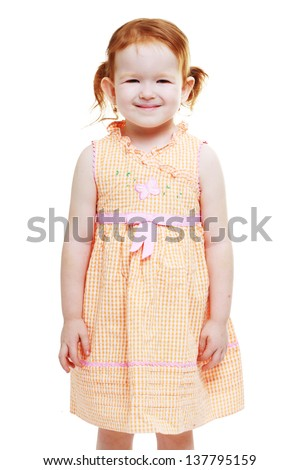 red haired 3 year old little girl smiling to the camera