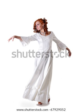 Red hairs woman dance waltz in snowy wedding dress, isolated on white - stock photo