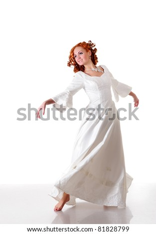 Red hairs woman dance waltz in snowy wedding dress, isolated on white