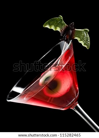 Red halloween cocktail with bloody eye - stock photo