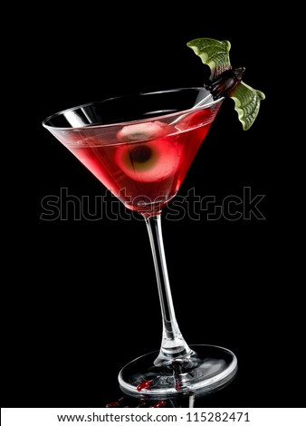 Red halloween cocktail with eye - stock photo