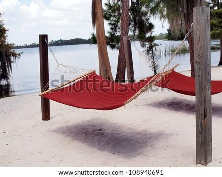 red hammocks on a Florida lake beach of white sand - stock photo