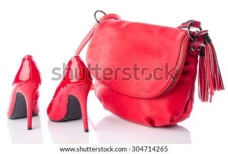 Red handbag and high heel shoes, isolated on white