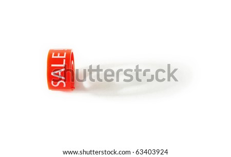 """Red hanger marker with """"Sale!"""" print throwing a shadow on a white background - stock photo"""