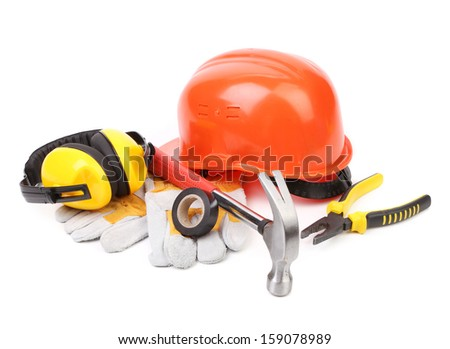 Red hard head gloves and tools. Isolated on a white background - stock photo