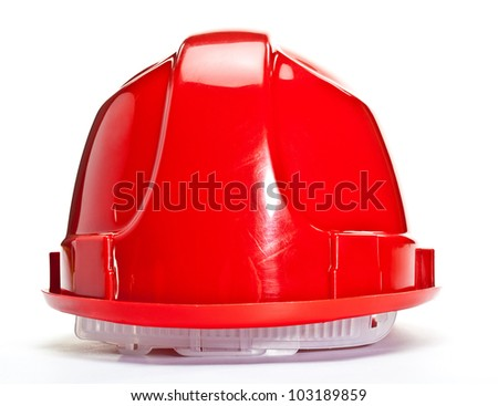 Red hardhat on white background; closeup of industrial hardhat - stock photo