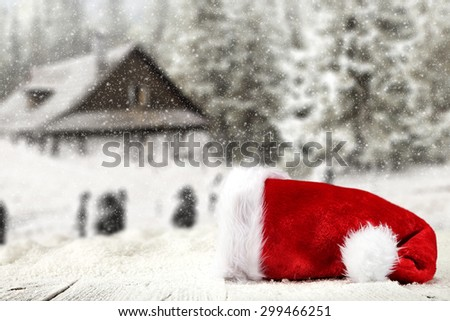 red hat on white table  - stock photo