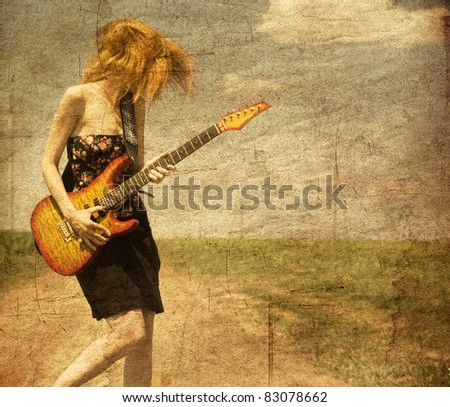 Red-head girl with guitar. Photo in old image style. - stock photo