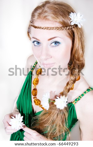 Red-headed sensual woman with flowers