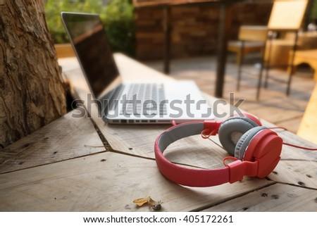 Red headphones outdoor. - stock photo