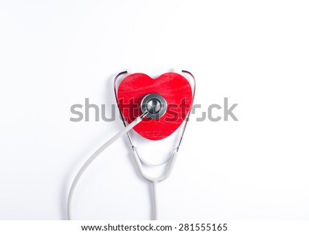 Red heart and a stethoscope. Medical concept - stock photo