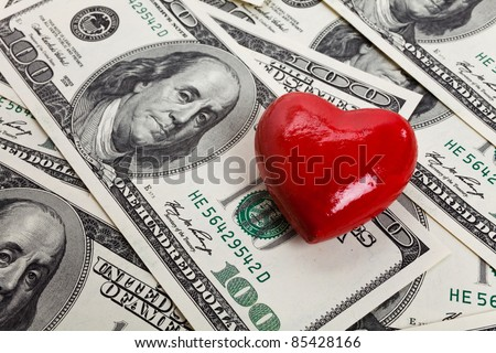Red Heart and Hundred Dollar Bills for background - stock photo