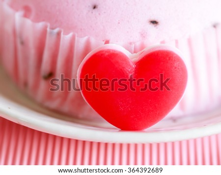 Red heart and pink soft cake in soft focus