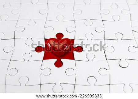 Red heart and Puzzle, love concept  - stock photo