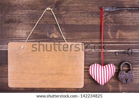 Red heart and sign board hanging on vintage wood background - stock photo