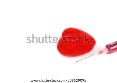 red heart and syring - stock photo