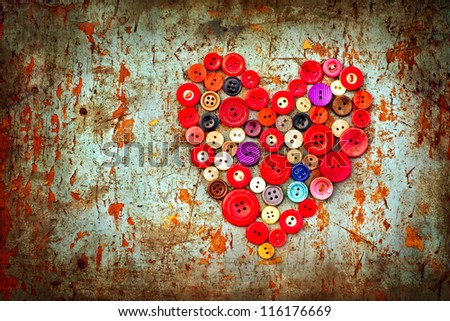 Red heart background on vintage old surface.Old colorful buttons/Valentines card with heart - stock photo