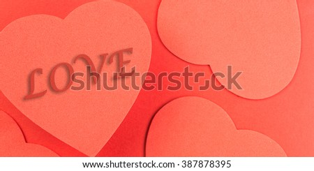 Red heart background with the word LOVE illustrated in text