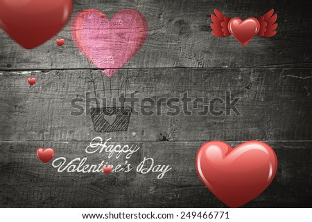 Red heart balloons floating against overhead of wooden planks - stock photo