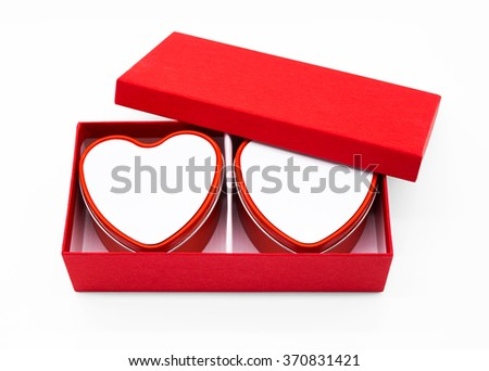 Red heart box package on white background. - stock photo