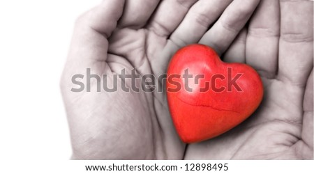 red heart covered in hands