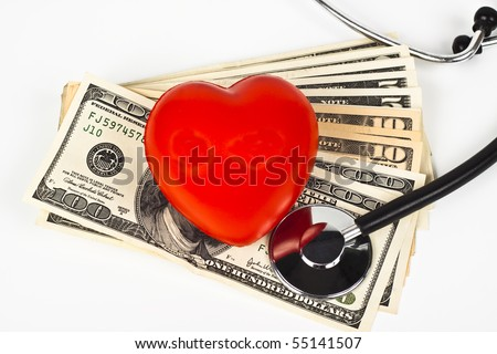 red heart dollar bills and a stethoscope on white background - stock photo