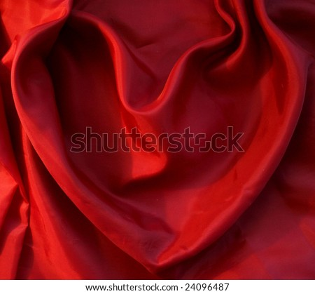 Red heart from elegant red silk for St Valentine's day background - stock photo