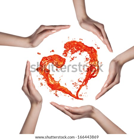 Red heart from water splash with human hands isolated on white - stock photo