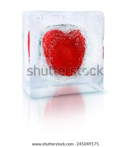 Red heart frozen inside an transparent ice cube block - stock photo