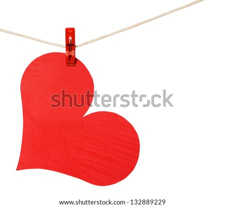 red heart hang on clothespin isolated on white background - stock photo
