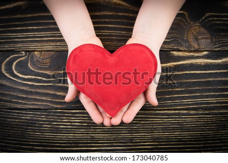 Red  heart in children's hands - stock photo