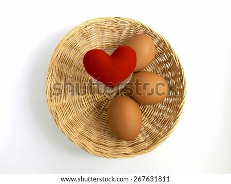 Red heart in egg basket for egg lover - stock photo