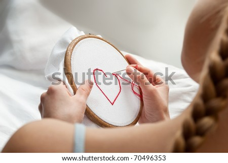 red heart in female hands - stock photo
