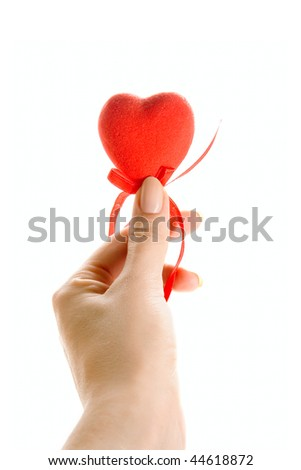 Red heart in human hand isolated on white