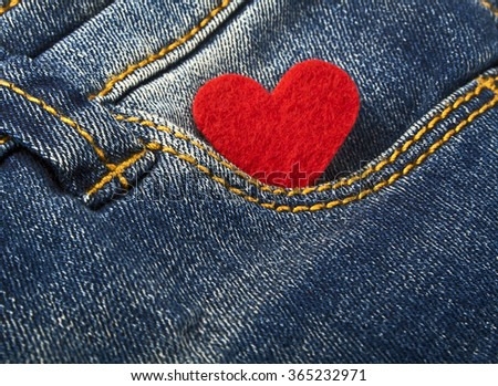 Red heart in jeans pocket - stock photo
