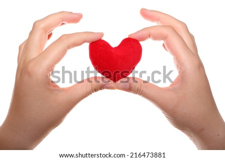 Red heart in the hands.