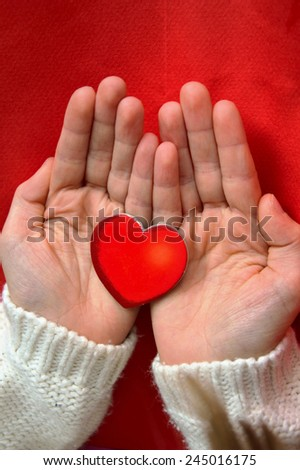 Red heart in the palms