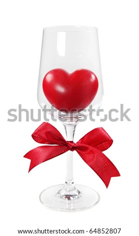 Red heart in wineglass - stock photo
