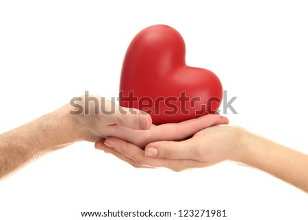 Red heart in woman and man hands, isolated on white - stock photo