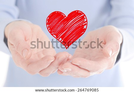 red heart in woman hand  - stock photo